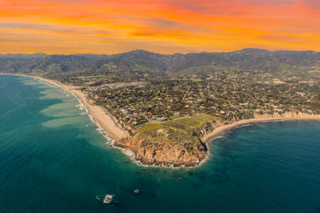 Aerial view of Point Dume State Park with sunset sky in Malibu, California.