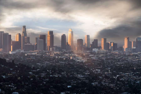 Downtown Los Angeles buildings with clearing morning clouds.
