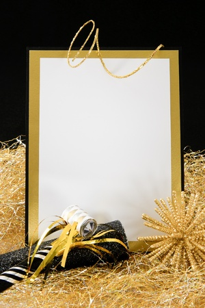 Black and Gold Blank Invitation or Sign with Copy-Space accented with Party Favors photo