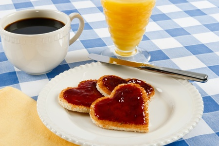 Red jam on toast hearts serve up a romantic Valentine breakfast Stock Photo - 8712537