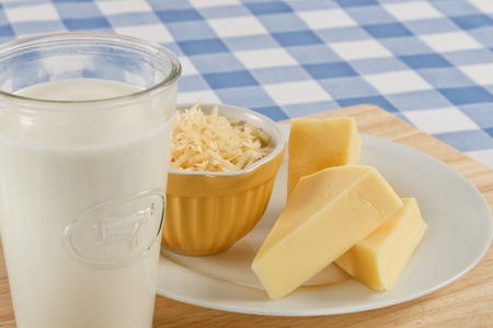 A snack of tasty Swiss cheese and a glass of milk can be a dangerous food allergen for many people. Фото со стока