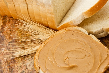 allergic ingredients: Peanut butter demonstrates a delicious snack or food allergen Stock Photo