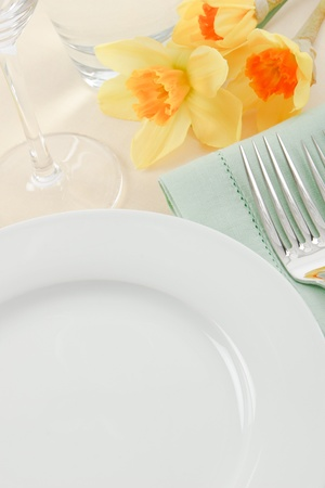 A pretty table setting in white, green and yellow has ample copy space for Spring and Mothers Day promotions