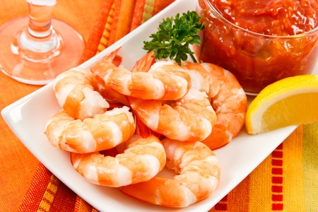 Fresh shrimp are a delicious gourmet appetizer and a dangerous food allergen. Stock Photo