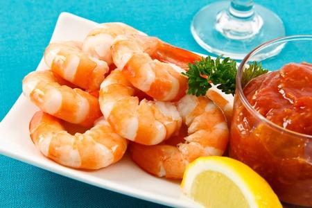 shrimp cocktail: Fresh shrimp are a delicious gourmet appetizer and a dangerous food allergen. Stock Photo