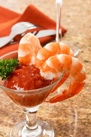 Three fresh shrimp are a delicious gourmet snack and a dangerous food allergen.