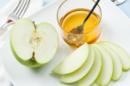 Apples and Honey are traditional symbols shared at Rosh Hashanah celebrations photo