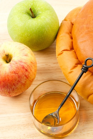 Apples and Honey and Challah Bread are traditional symbols shared at Rosh Hashanah celebrations