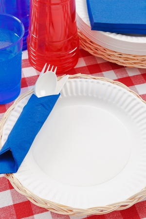 Red, white and blue picnic table setting is ready to celebrate  a festive summer holiday meal. photo