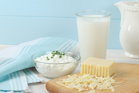 Healthy, fresh dairy products include cottage cheese, swiss cheese and a glass of milk Banco de Imagens