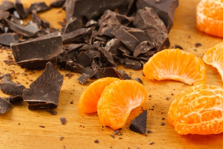 semisweet: Close up of Mandarin Orange wedges with crushed dark chocolate. Stock Photo