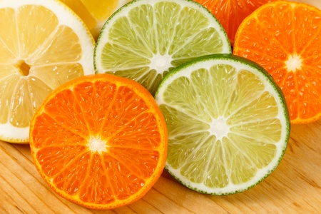 citruses: Close up shot of fresh, juicy sliced limes, lemons and mandarin oranges Stock Photo