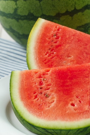 Juicy fresh red watermelon slices are a favorite summer fruit and a healthy, delicious treat photo
