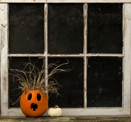 jackolantern: Surprised Jack-O-Lantern On A Window Ledge Stock Photo