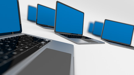 Many laptops in a circle isolated on white. Shallow depth of field.