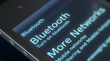 A splendid 3d rendering of a smart phone with sparkling inscription Bluetooth More Networks icon. The screen of a phone is placed askew in the black background