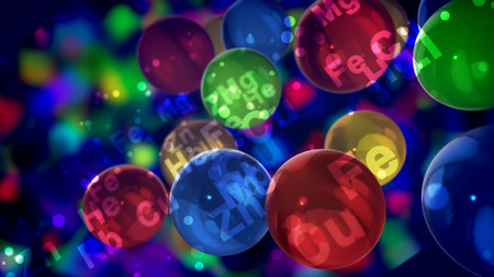 A cheery 3d illustration of see-through colorful balls with the signs of chemical elements shining brightly nearby and flying around in a jovial way in the black background.