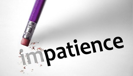 patience: Eraser changing the word Impatience for Patience  Stock Photo