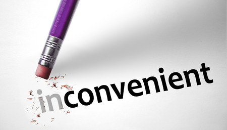 inconvenient: Eraser changing the word Inconvenient for Convenient  Stock Photo