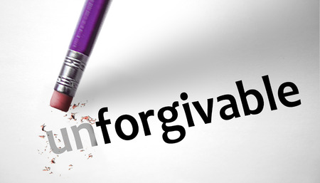 Eraser changing the word Unforgivable for Forgivable  Stock Photo