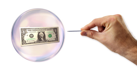 overvalued: Dollar economic Bubble about to explode by a needle  Stock Photo