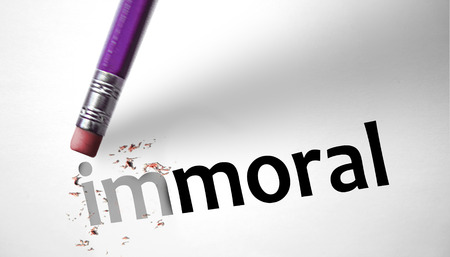 immoral: Eraser changing the word Immoral for Moral  Stock Photo