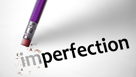 imperfection: Eraser changing the word Imperfection for Perfection  Stock Photo