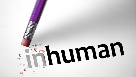 Eraser changing the word Inhuman for human  photo