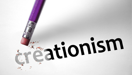creationism: Eraser deleting the concept Creationism  Stock Photo