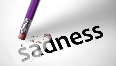 Eraser deleting the word Sadness Stock Photo - 29559254