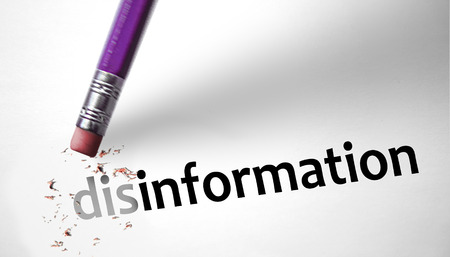 disinformation: Eraser changing the word disinformation for information  Stock Photo