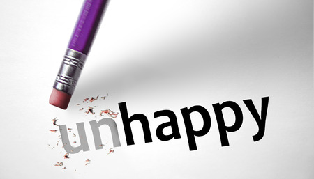 Eraser changing the word Unhappy for Happy  Stock Photo