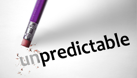 suddenness: Eraser changing the word Unpredictable for Predictable  Stock Photo