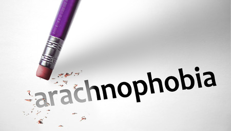 deleting: Eraser deleting the word Arachnophobia