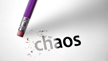 chaos theory: Eraser deleting the word Chaos