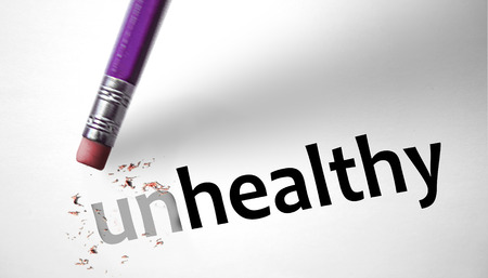 Eraser changing the word Unhealthy for Healthy  photo