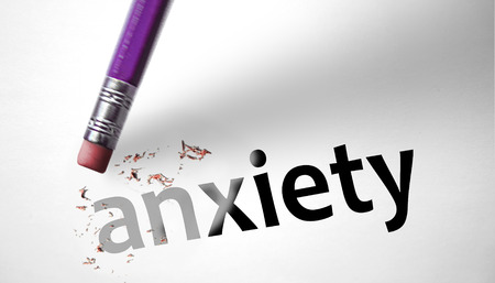 psychopathy: Eraser deleting the word Anxiety  Stock Photo