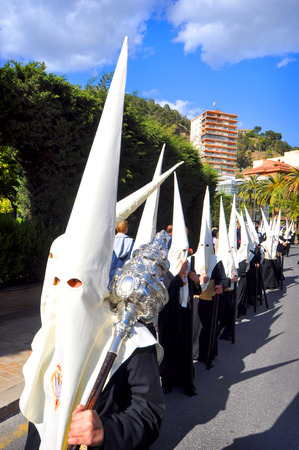 semana santa: MALAGA, SPAIN - APRIL 09: Nazarenes and musicians from Semana Santa (Easter) catholic parade in the streets in April 09, 2009 in Malaga, Spain