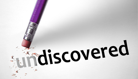 Eraser changing the word Undiscovered for Discovered  photo