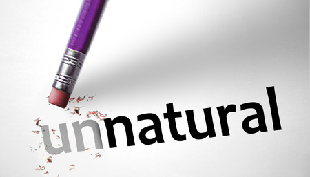 unnatural: Eraser changing the word Unnatural for Natural  Stock Photo