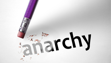 anarchism: Eraser deleting the word Anarchy  Stock Photo