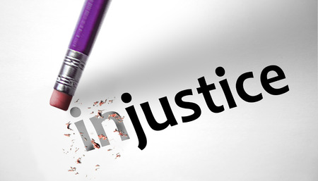 restraining: Eraser changing the word Injustice for Justice