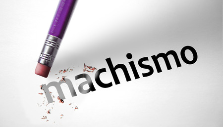 domestic violence: Eraser deleting the word Machismo  Stock Photo