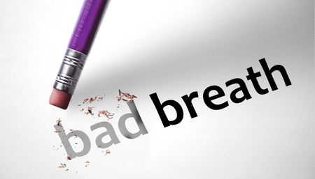 Eraser deleting the words Bad Breath  Stock Photo