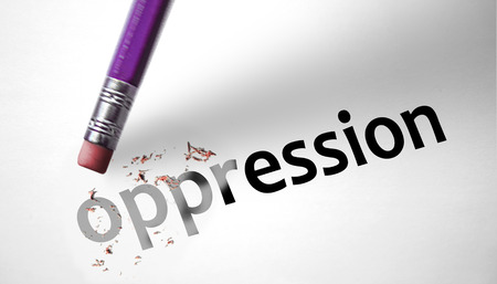oppression: Eraser deleting the word Oppression