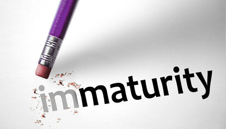 Eraser changing the word Immaturity for Maturity  Banco de Imagens