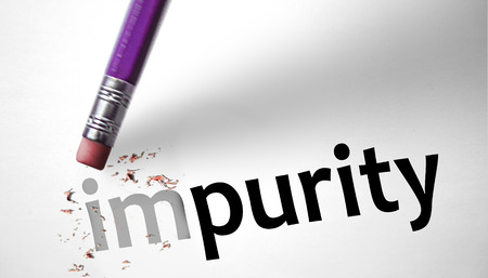 impure: Eraser changing the word Impurity for Purity  Stock Photo