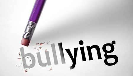 Eraser deleting the word Bullying  photo