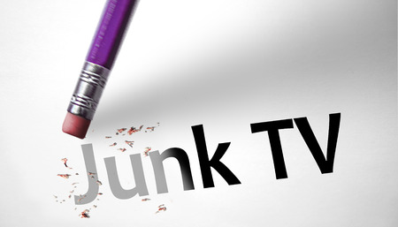 deleting: Eraser deleting the concept Junk TV  Stock Photo