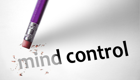 deleting: Eraser deleting the concept Mind Control  Stock Photo